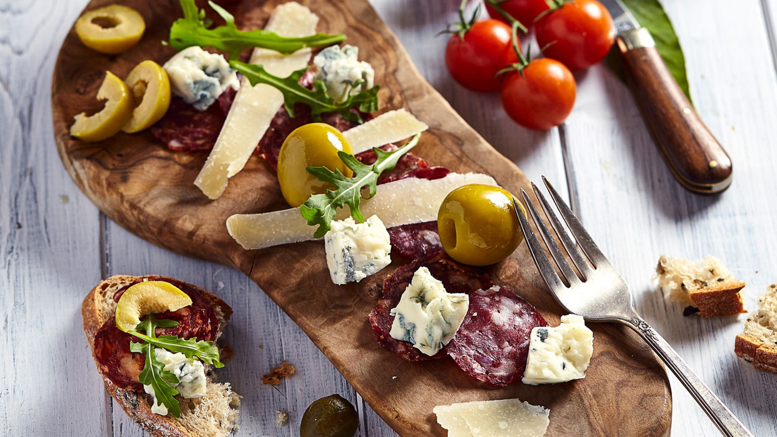 Antipasti selection of sliced charcuterie, rosemary gordal olives, aged parmesan & gorgonzola